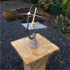 Orbdial installed on veined marble pedestal