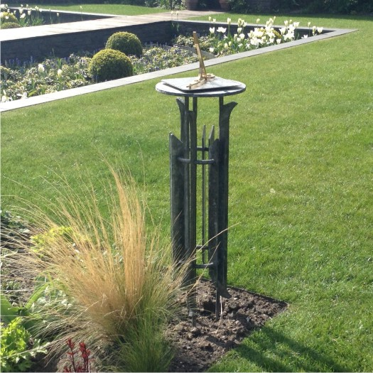 A horizontal sundial and ironwork stand