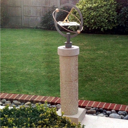 An armillary sundial and sandstone pillar