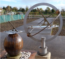 Two sundials with stoneware globe and armillary rings in November sun