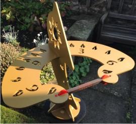 Morning sunshine on the Dihelion sundial in a garden at Edinburgh