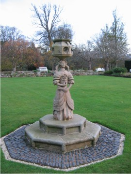 Scottish sundial stone supported by pedestal in the form of a lady